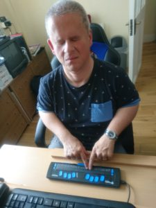 Brian using a braille display